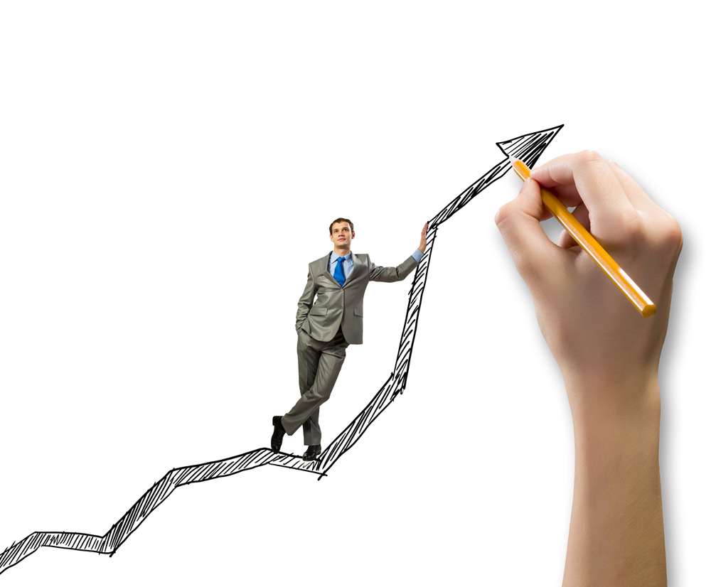 Young businessman standing on drawn graph arrow